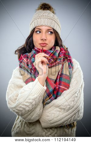 Thoughtful Trendy Woman In Winter Fashion