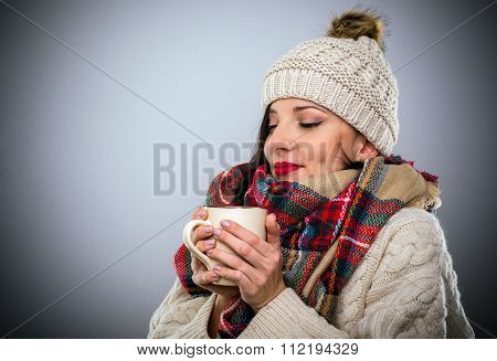 Blissful Woman Enjoying A Mug Of Hot Coffee