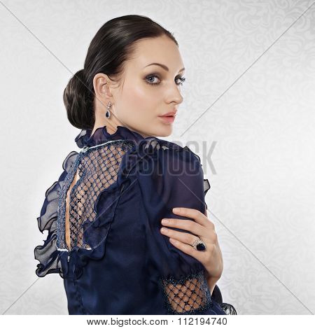Portrait of elegant beautiful woman on light background