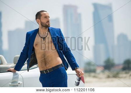 Man on the background of skyscrapers