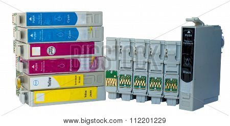 stack of used ink colored cartridges