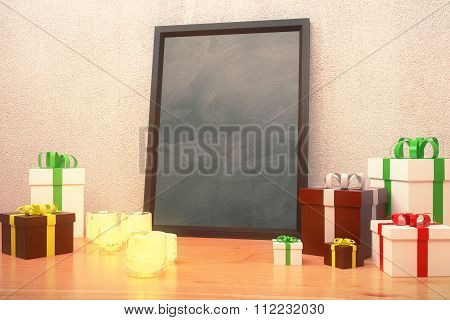 Blank Black Picture Frame With Gift Boxes And Candlesticks On Wooden Floor, Mock Up