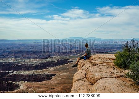 Male Hiker Overlooking Grand View In Canyonlands