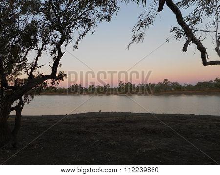 Dusk over Camoweal Billabong in Queensland, Australia