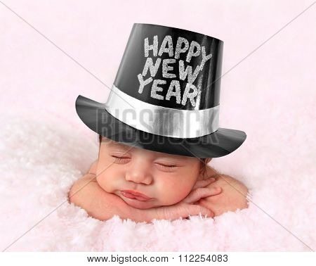 Newborn baby girl wearing a Happy New Year hat.