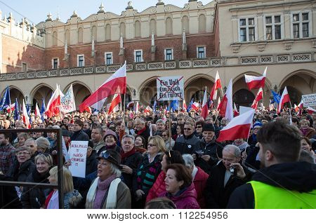 CRACOW POLAND - DECEMBER 19 2015: Cracow Main Square - The demonstration of the Committee of the Protection of Democracy / KOD/ against the break of law through the government PIS in Poland.