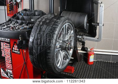 Car Service. Balancing Tire Wheel Machine