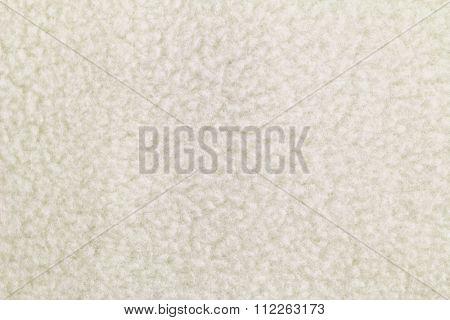 Closeup background photo of texture of Off white heat retaining fleece textile