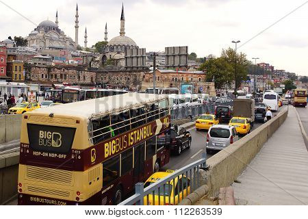 ISTANBUL, TURKEY - OCTOBER 03, 2014: Tour bus in front of the New Mosque. The Yeni Cami, meaning New