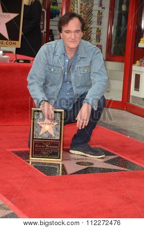 LOS ANGELES - DEC 21:  Quentin Tarantino at the Quentin Tarantino Hollywood Walk of Fame Star Ceremony at the Hollywood Blvd on December 21, 2015 in Los Angeles, CA