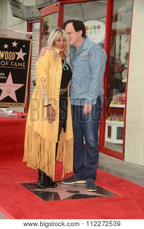 LOS ANGELES - DEC 21:  Pam Grier, Quentin Tarantino at the Quentin Tarantino Hollywood Walk of Fame Star Ceremony at the Hollywood Blvd on December 21, 2015 in Los Angeles, CA