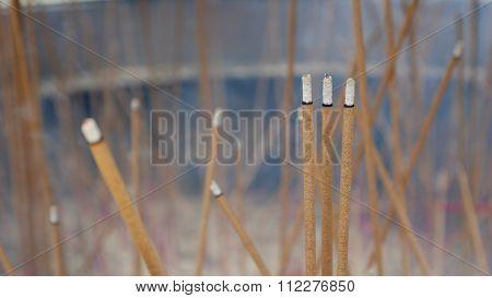Joss sticks burning in big joss stick pot