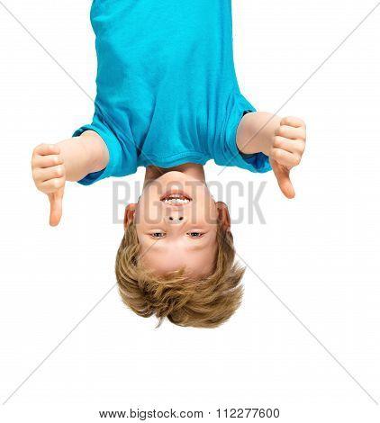 Handsome little boy hanging upside down