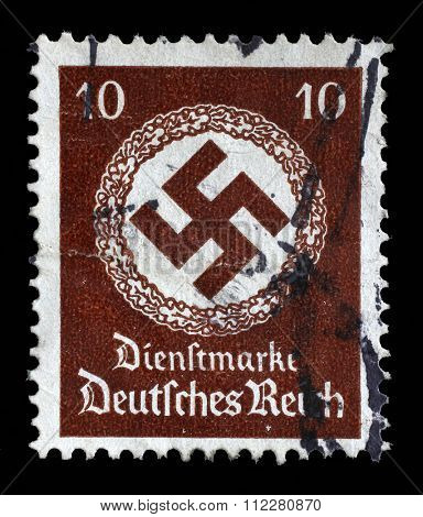 GERMANY - CIRCA 1942: A postage stamp printed in Germany shows the Swastika in an oak wreath, circa 1942.