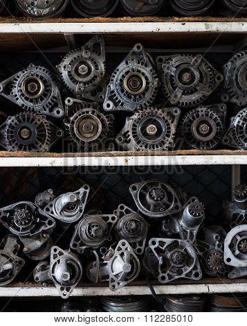 Old Car Alternators On Shelf.
