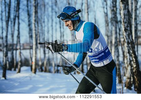 closeup young athlete race skier in winter forest classic style