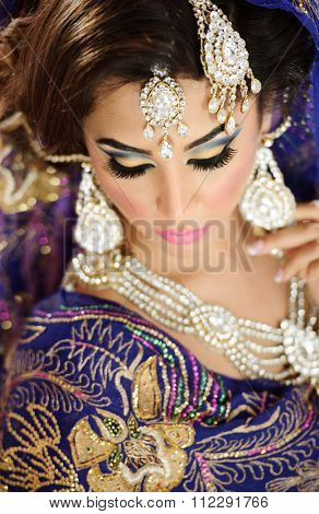 Beautiful traditional bride with heavy jewellery and ethnic jewellery poster