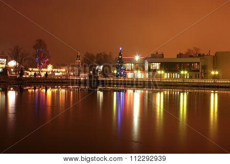 Christmas Tree On Lake Embankment At Night