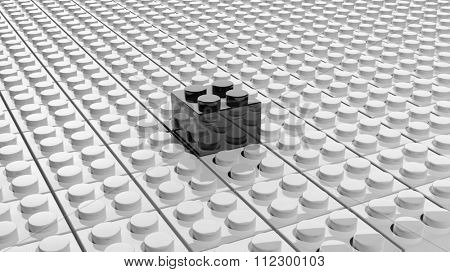 Connected white lego blocks with one black standing out, abstract background.