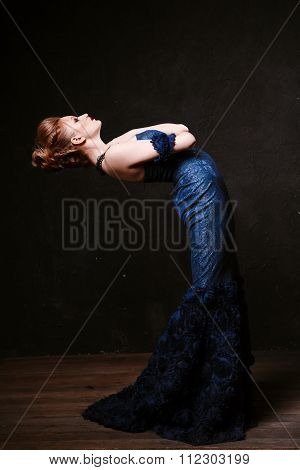 Studio Shoot Of Posing Woman In Long Blue Dress. Retro Style.