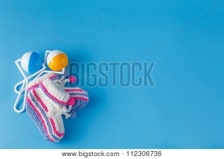 Rattles For The Newborn On Blue Background