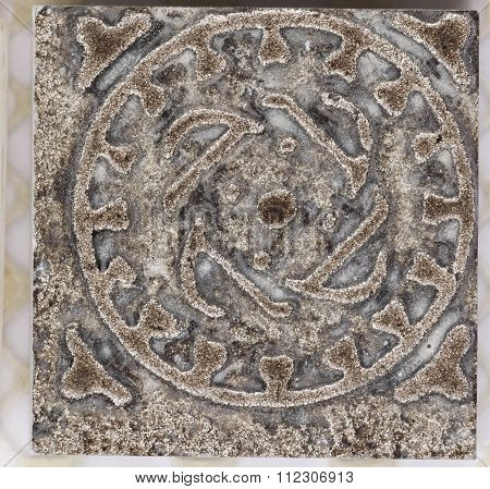 Ceramic Surface With An Ornament And Patina