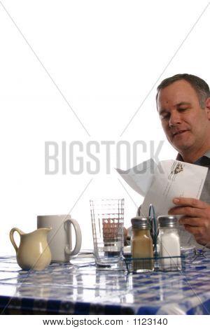 Man Reading Letter In Diner