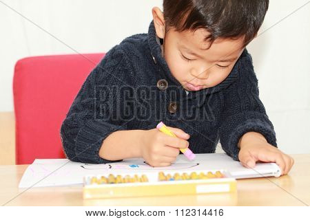 Japanese boy drawing a picture (4 years old)