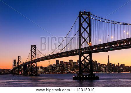 San Francisco Skyline And Bay Bridge At Sunset, California