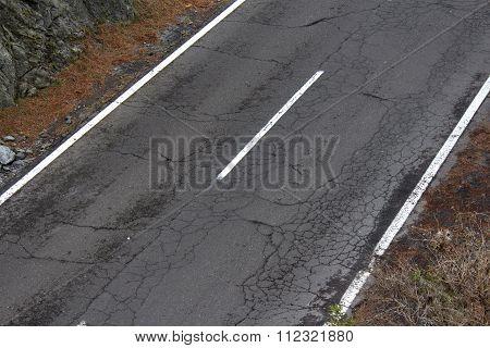 old cracked asphalt street / damaged road