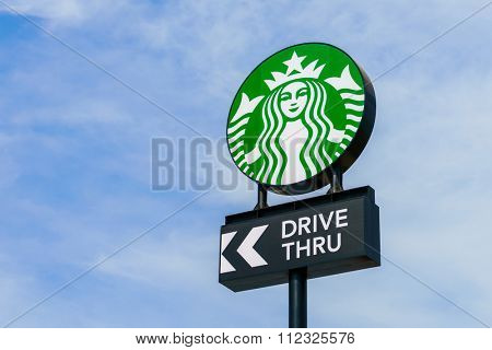 Khonkaen Province, Thailand - December 20, 2015 : Starbucks drive thru sign at 200th store at FastFac Mini Factory one of the fastest growing industrial