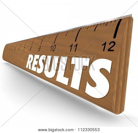 Results word on 3d wooden ruler to illustrate findings or performance measurement