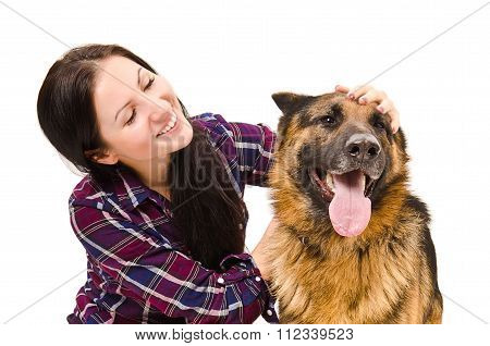 Portrait of beautiful young woman and a German Shepherd
