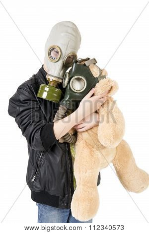 Caucasian Teen Child With Toy In Gas Mask