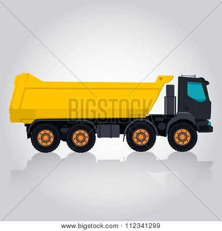 Yellow big truck builds roads.