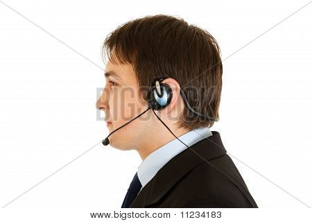 Thoughtful modern businessman with headset isolated on white