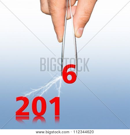 umbers 2016 and hand with tweezers