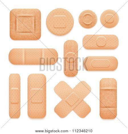 Set of first aid patches of different forms like tapes square and circles isolated vector illustration
