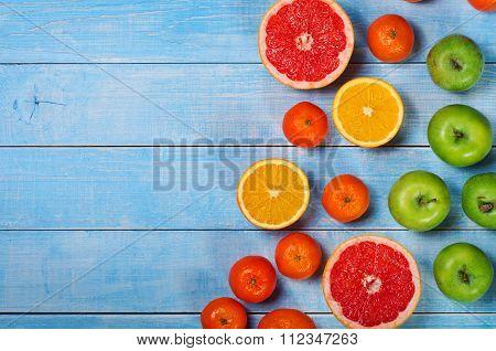 Fruit Background - Grapefruit, Apples, Oranges And Tangerines