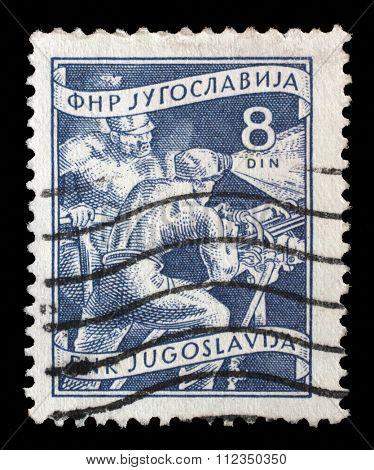 YUGOSLAVIA - CIRCA 1952: A stamp printed in Yugoslavia shows miners, domestic economy Series, circa 1952
