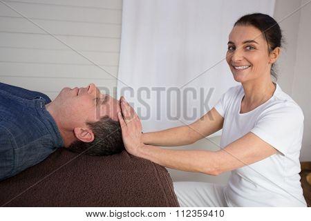 Professional Reiki Healer Doing Reiki Treatment To A Man