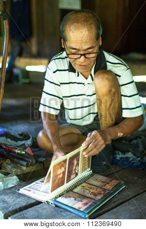 KOH CHANG - THAILAND - DEC 19, 2015: Unidentified local man of the Ko Chang island. The island is part of marine national Park Mu Ko Chang. Ko Chang population of 5356 people living in 8 villages.