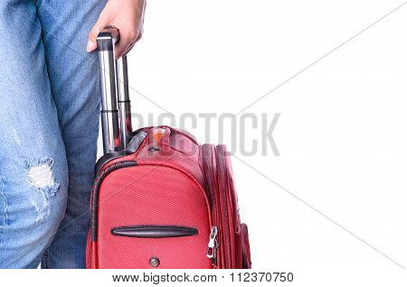Woman holds suitcase in hands.