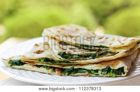 Gozleme. Turkish flatbread with greens. Shallow depth of field