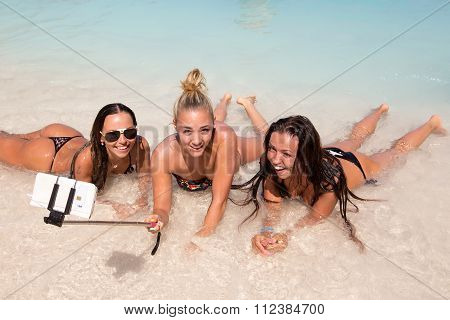 Tourist Girls Doing A Selfie At The Seaside Of Navagio Beach In Zakynthos, Greece.