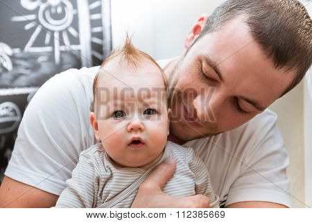 Dad holding his little baby girl