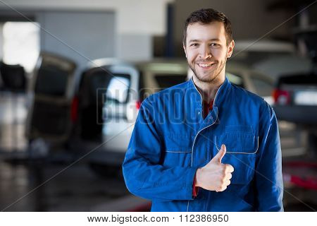 Handsome smiling mechanic
