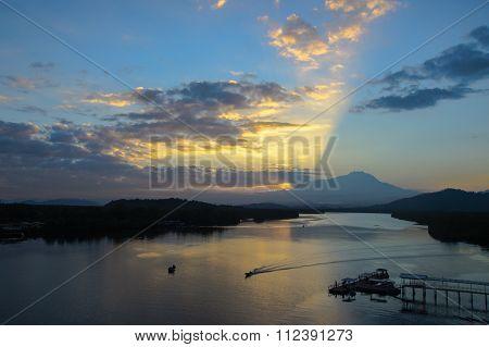 Beautiful sunrise with the view of Mount Kinabalu, at Mengkabong Bridge, Tuaran