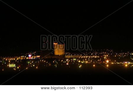 looking out over reno nevada at the night skyline of the city. poster