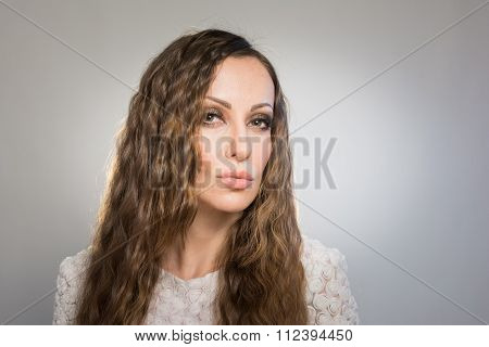 Beautiful young woman with makeup and long hair